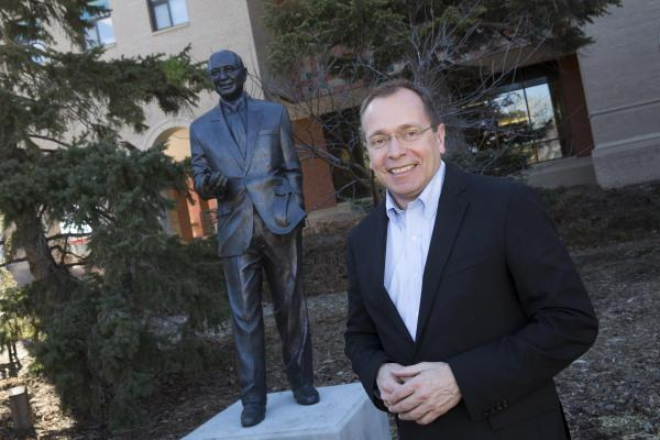 Phil Karsting, Nebraska native and Foreign Agricultural Service Administrator at the U.S. Department of Agriculture with statue of Clayton Yeutter, former U.S. Trade Ambassador and U.S. Secretary of Agriculture, and fellow UNL agricultural economics alumnus.