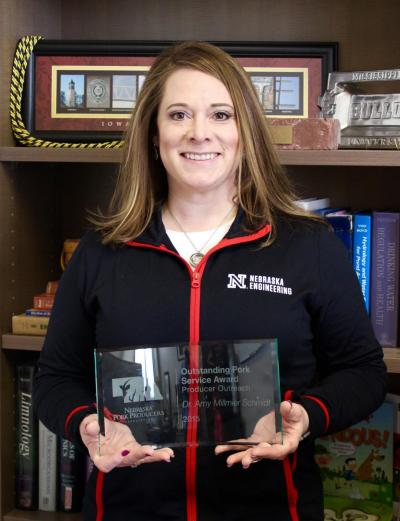 Schmidt receives outstanding service award