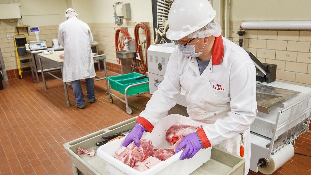 A worker processing pork