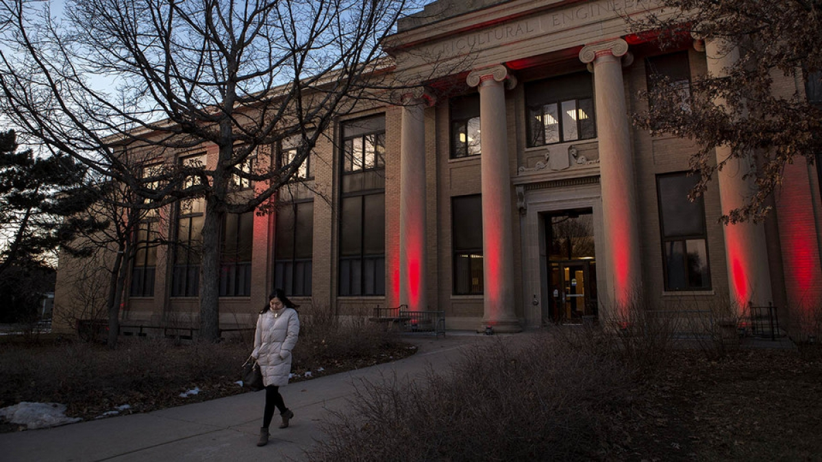 A student walking out of the Agricultural Engineering building. Links to larger image.