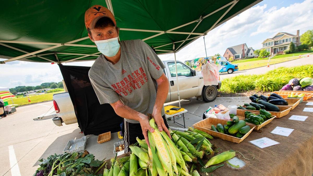 man selling corn