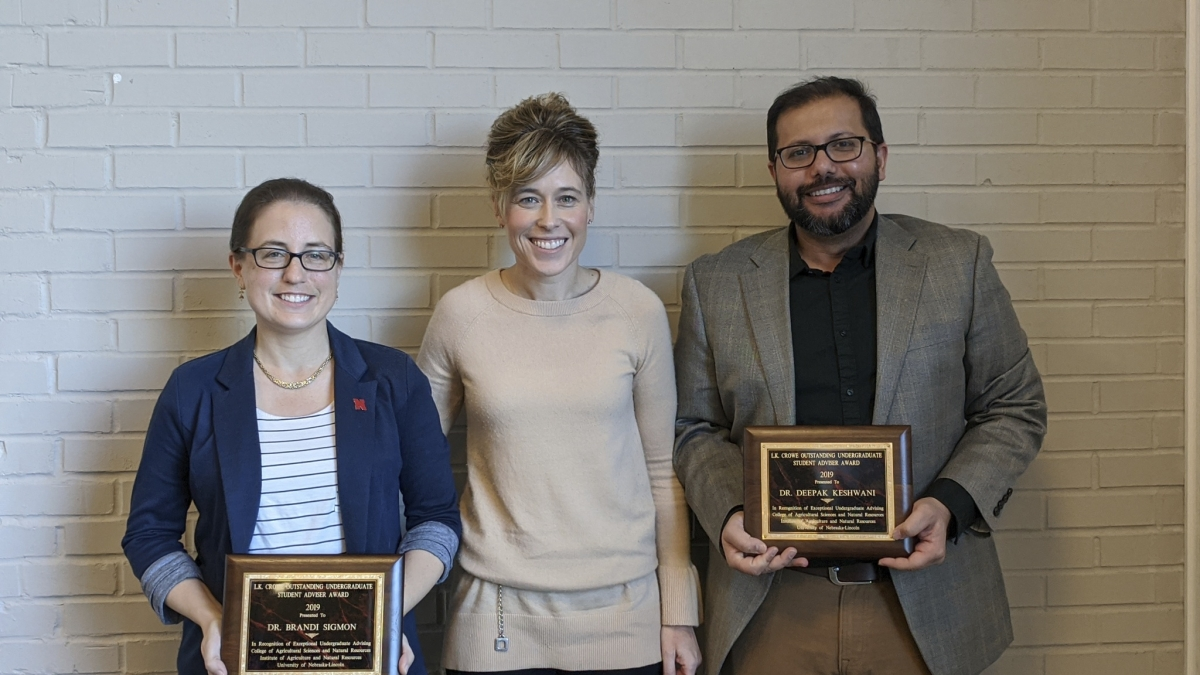 CASNR Dean Tiffany Heng-Moss (center) presents the Lawrence K. Crowe Outstanding Undergraduate Advising Award to Brandi Sigmon (left) and Deepak Keshwani (right).