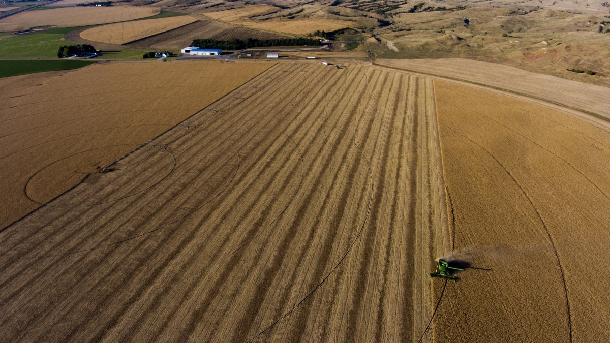 Aerial view of tractor plowing a field