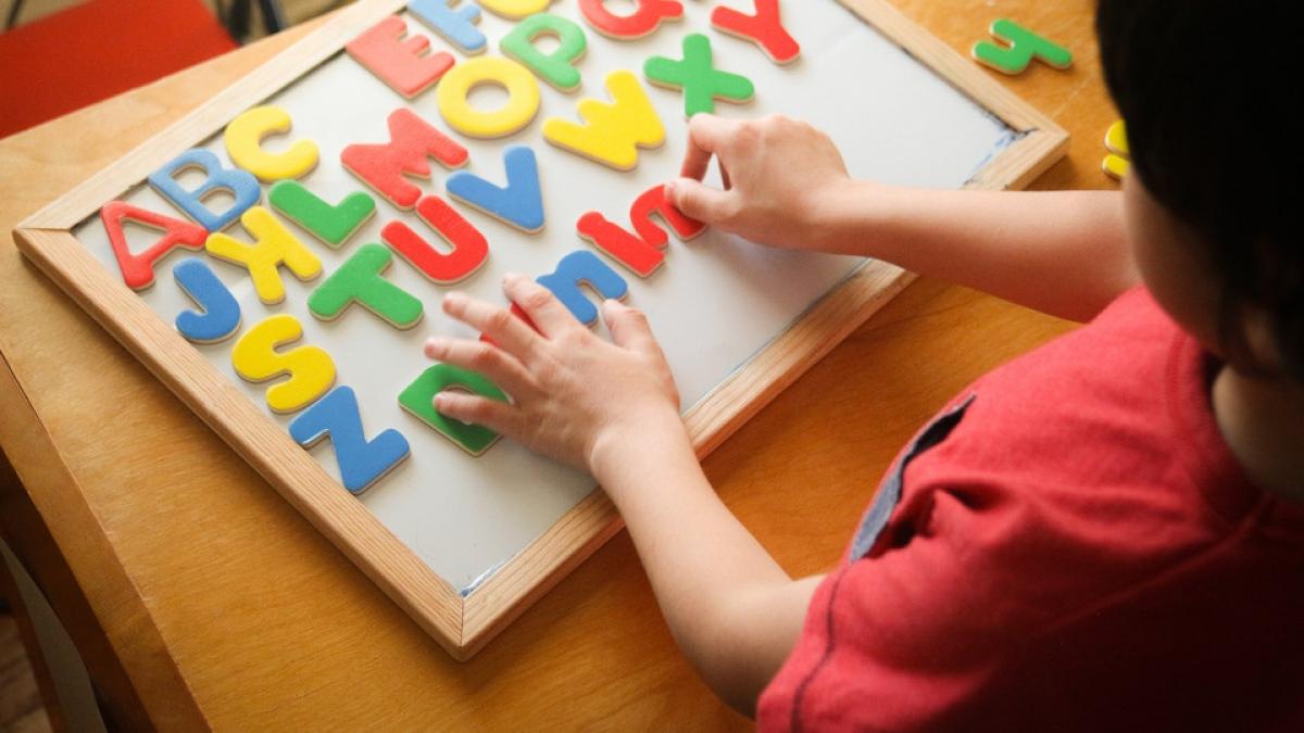 child learning alphabet
