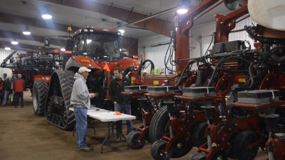 presenter showing tractors to participant at 2018 Soybean Day and Machinery Expo