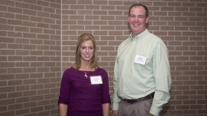 Heidi Miller and teacher Kevin Anderson. Links to larger image.