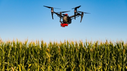 Drone surveying a field