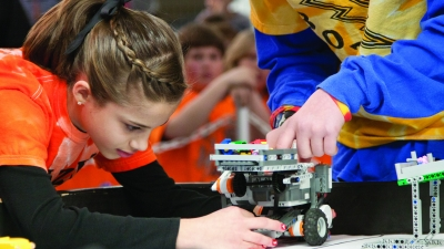 A student testing a wheeled robot. Links to larger image.