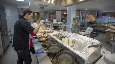 chef cooking in dining hall