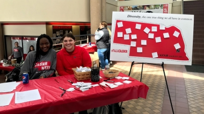 students at welcoming booth