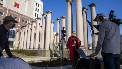 Ronnie Green being filmed in front of Memorial Stadium