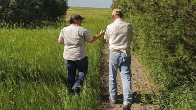 farmers walking on trail