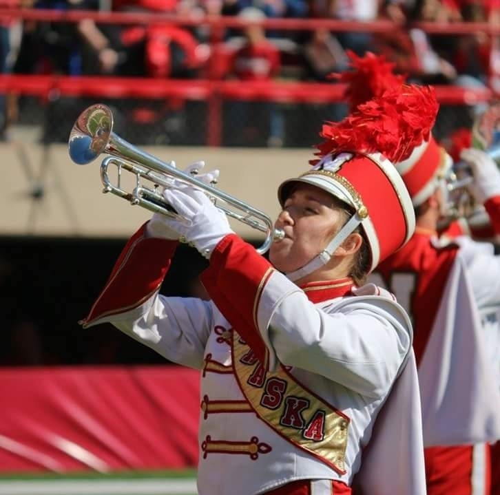 Shannon Rezac playing trumpet with the University of Nebraska marching band. Links to larger image.