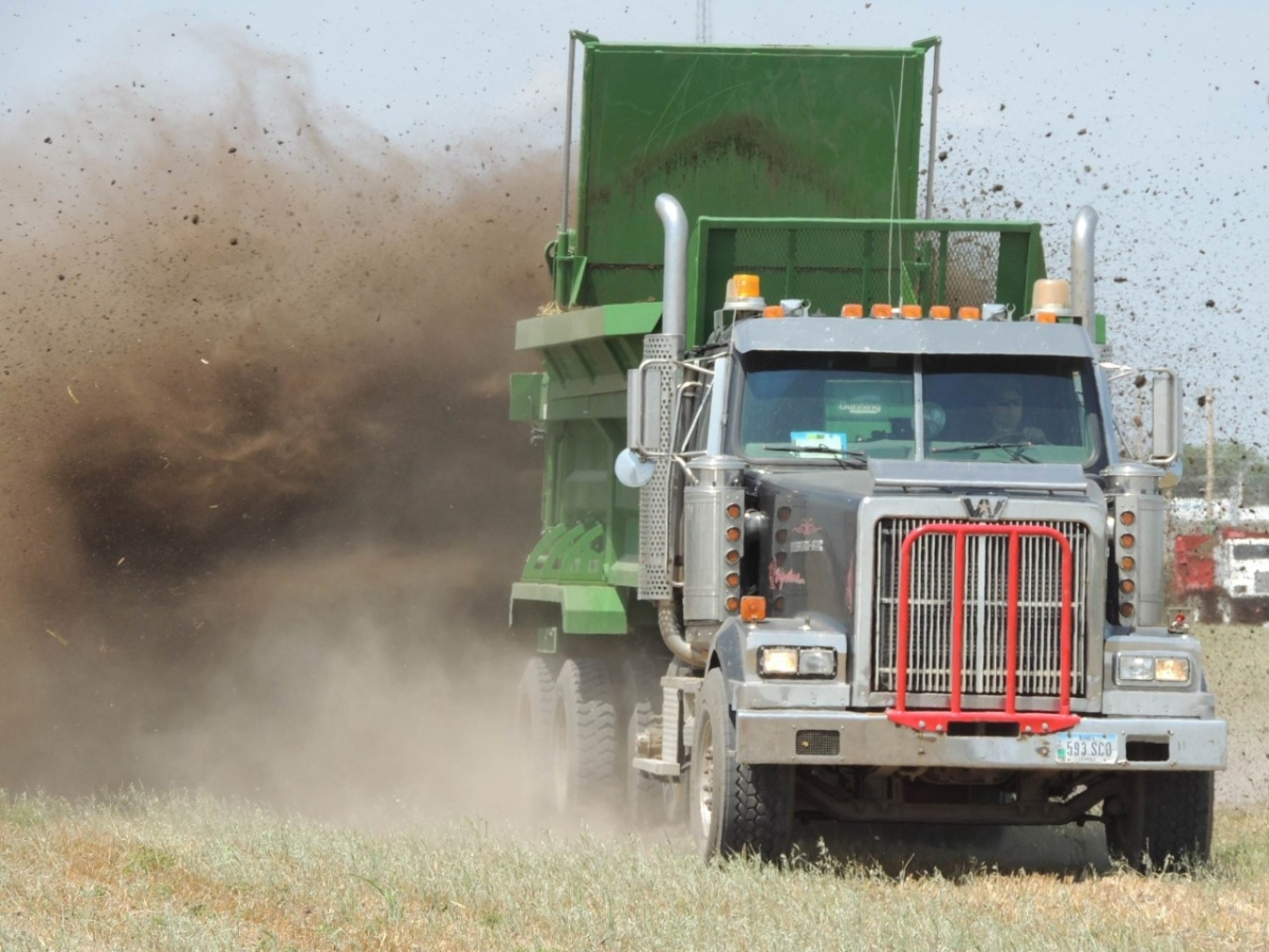 a truck spreading manure