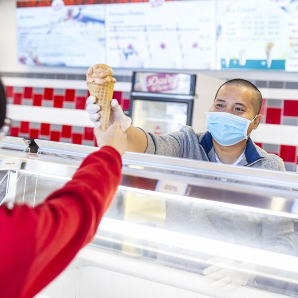 Duy Nguyen serves up a cone of his favorite flavor, Butterscotch Frost.